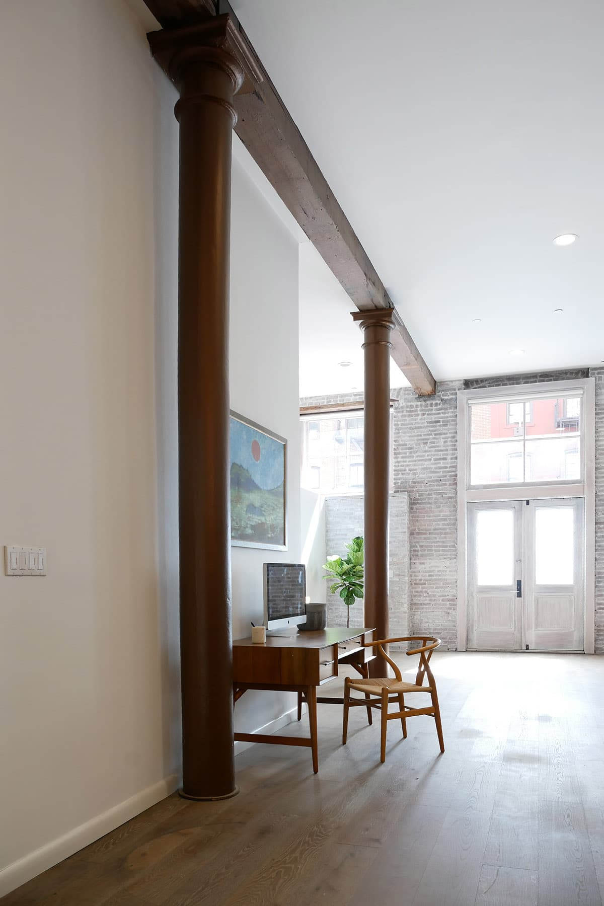 Cast Iron Columns and Wood Beam in a SoHo Loft, NYC
